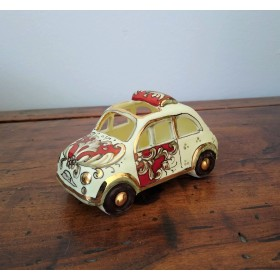 Little car in gold and ruby