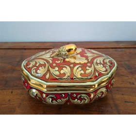 Box with ruby and gold