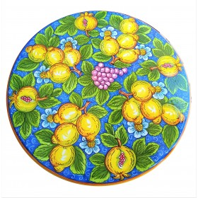 Table top with light blue lemons and pomegranates