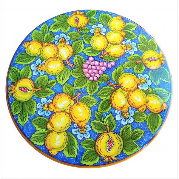 Tavolo limoni e melograno fondo azzurro - Ceramiche Sberna